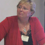 Dr. Magda Havas speaking at a conference